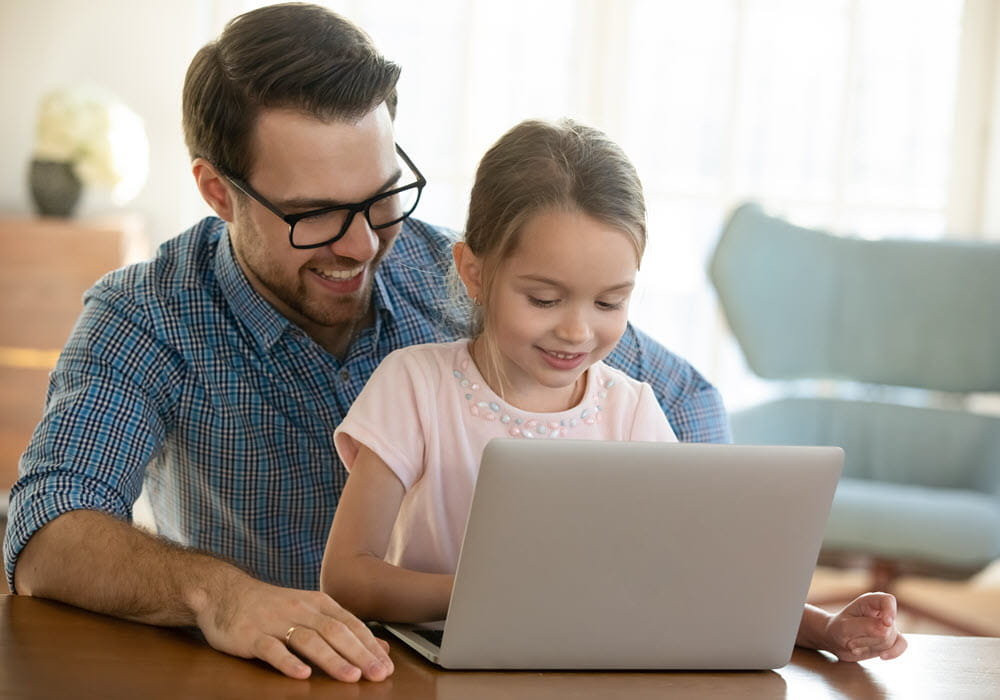Father and daughter on laptop